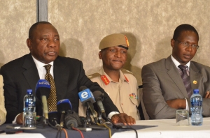 Cyril Ramaphosa, with Lt. Gen. Kamoli and Brigadier Mahao, as the SADC mediator answered a question at the Oct. 23, 2014, signing of the SADC security deal. (Photo by Michael J. Jordan)